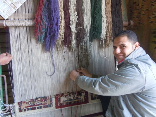 Visited a carpet factory where, of course, Bernie bought something. He was a very good tourist. All the fabric is naturally dyed. The worker obviously has had his picture taken by many eager travelers.